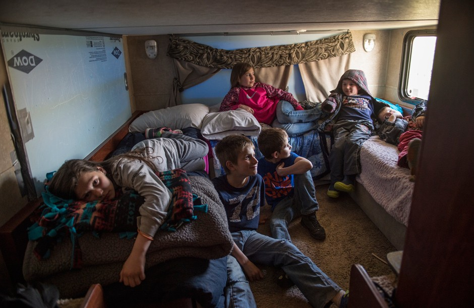 Justin and Mandy Tolbert's children squeeze into the 36-foot camper in Bainville, Montana, where they have lived for almost two years.